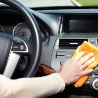 claning car dashboard with a microfiber cloth