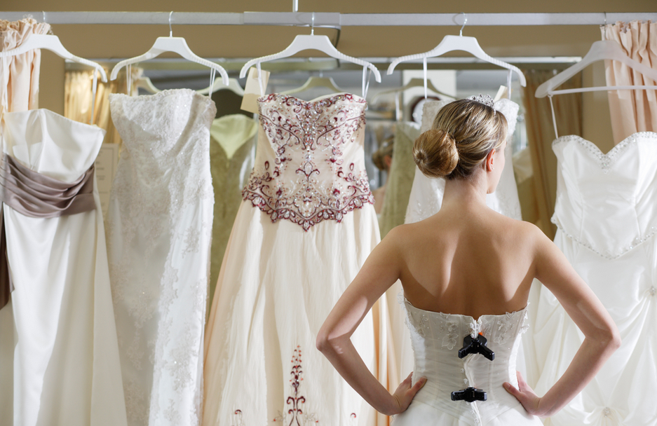bride choosing wedding dresses