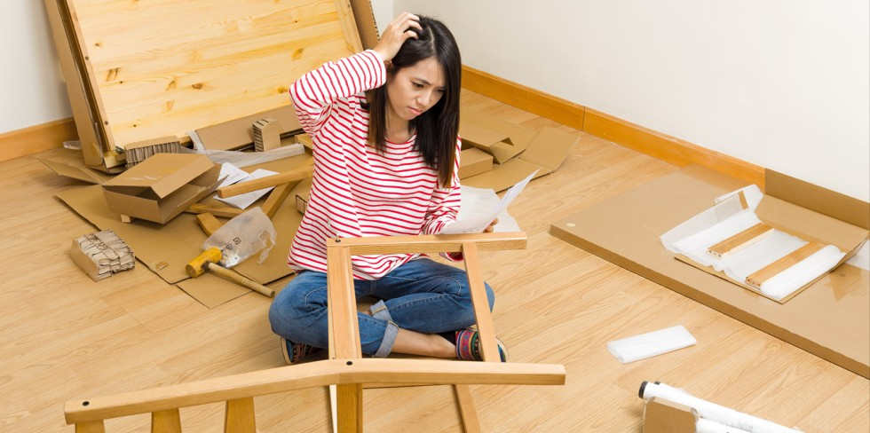 Beau Young Woman Trying To Figure Out How To Assemble A Chair