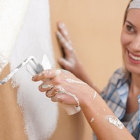 woman rolling the wall and smiling