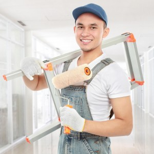 handyman with roller and ladder