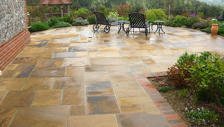 How to build a stone patio on your own hirerush blog for Small stone patio ideas