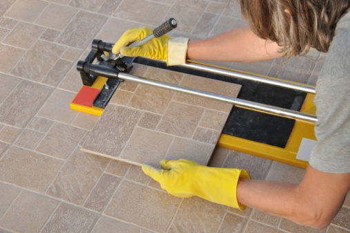How to tile a shower wall and floor 7 steps hirerush blog woman tile contractor cutting a tile ppazfo