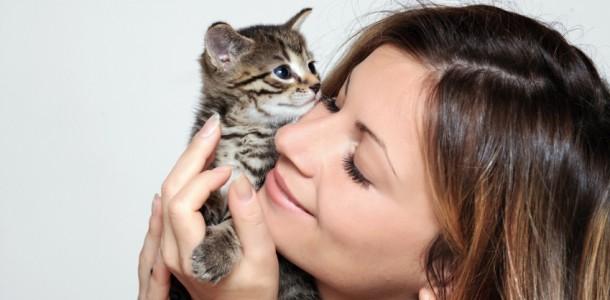 woman holding a little kitten