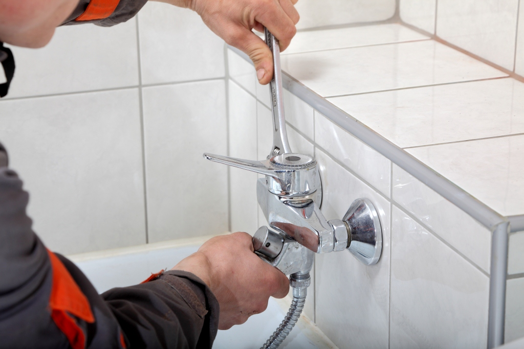 plumber installing faucets