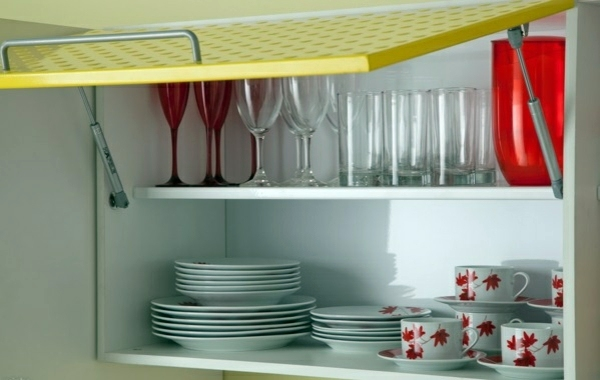 plates, glasses and cups in cabinet
