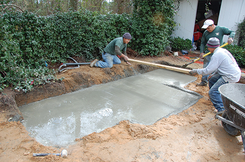 contractors building a base for outdoor fireplace