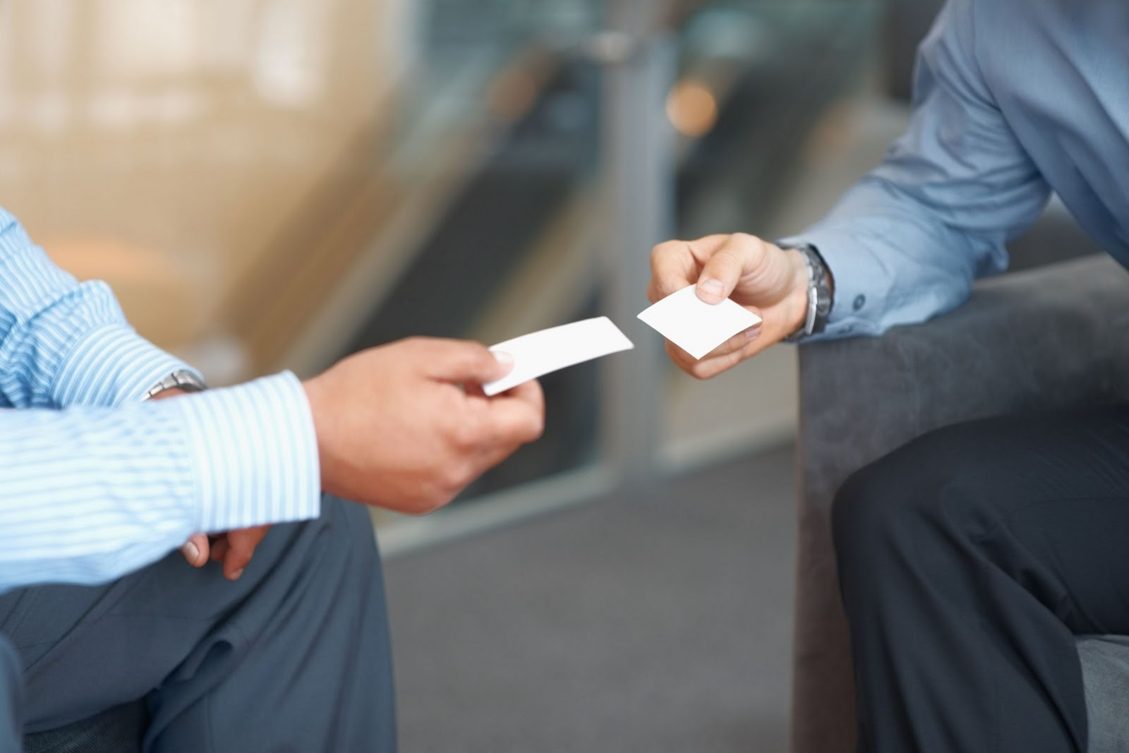 men exchanging business cards
