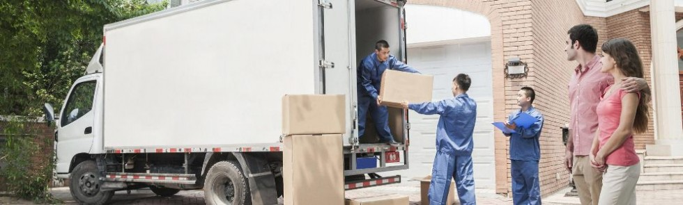 movers loading a truck and clients watching them