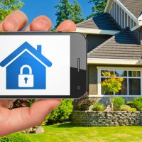 house and phone with home security app