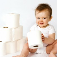 potty training boy a little boy with rolls of toilet paper