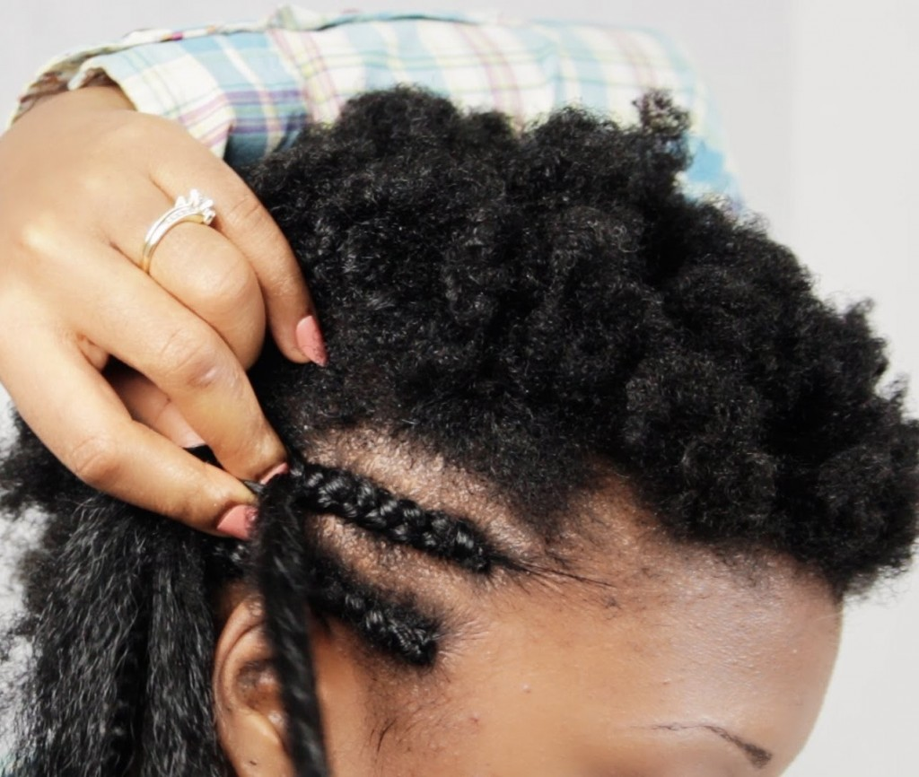woman braiding crownrow braids on her hair