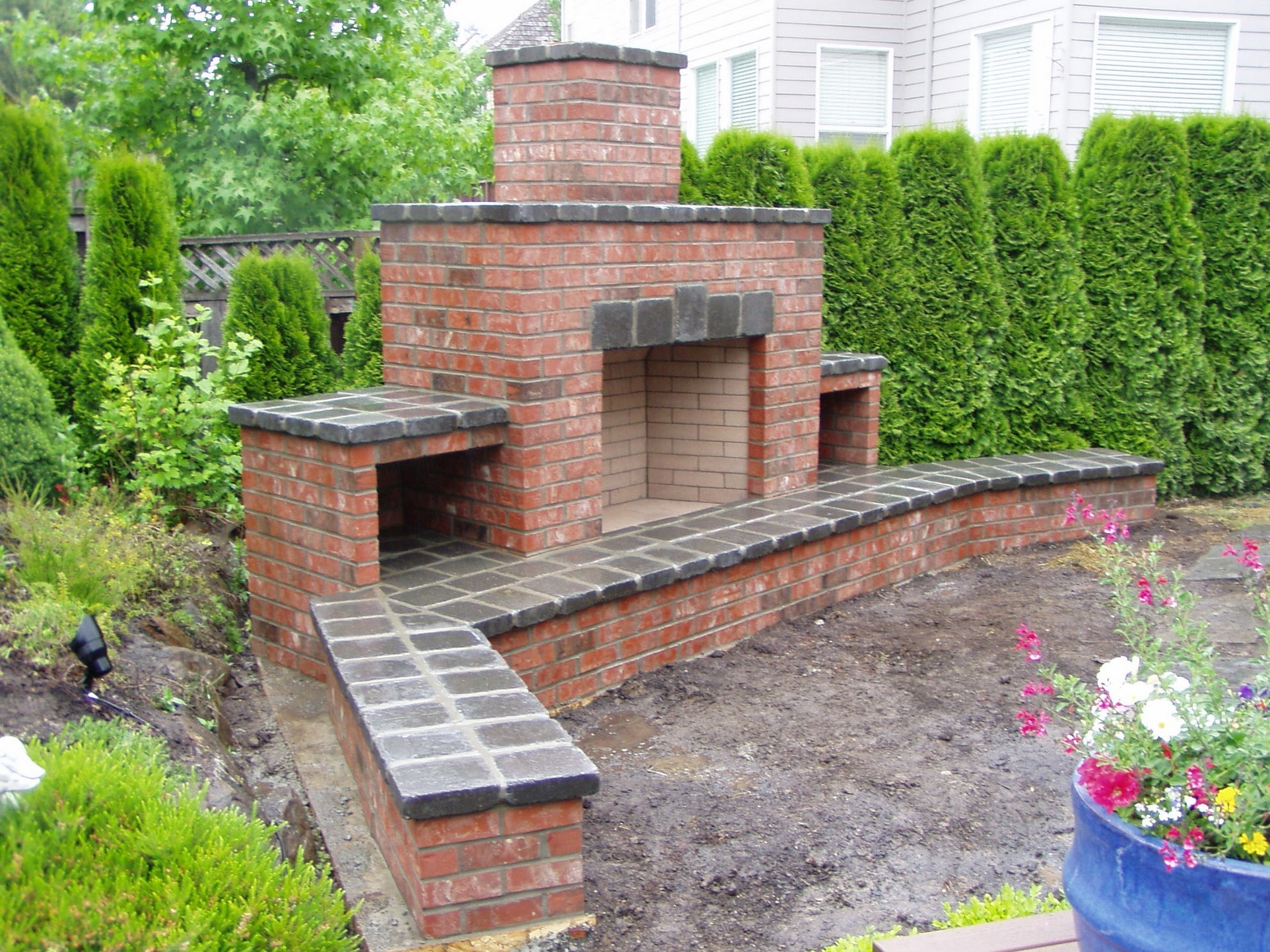 unfinished red brick fireplace