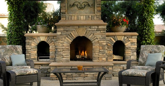 outdoor fireplace on patio with chairs and coffee table