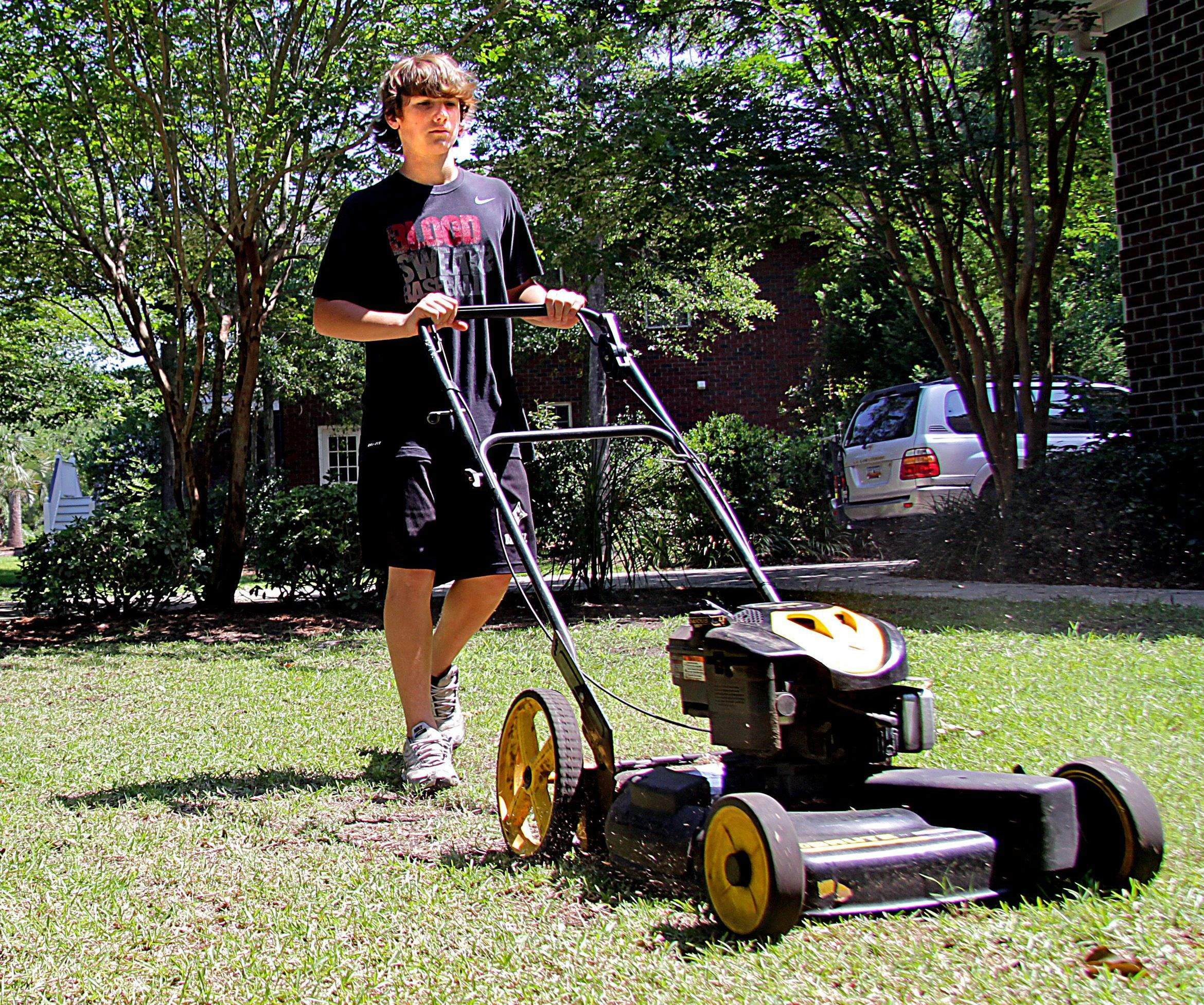 6 steps of how to start a lawn care business hirerush teenage boy mowing the lawn