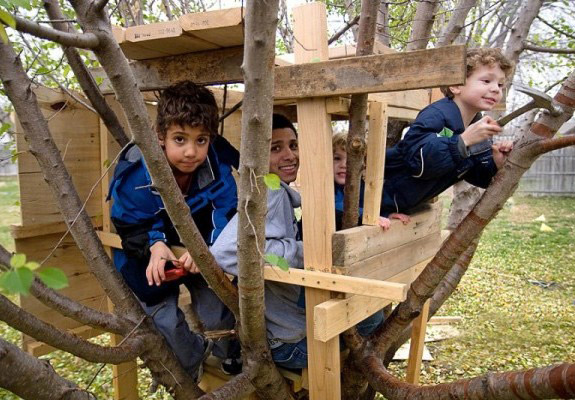 kids helping their dad to build a tree house