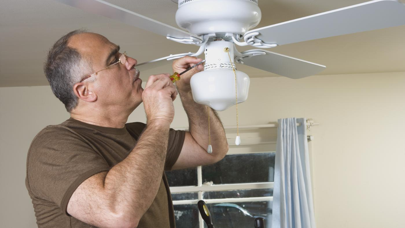 8 steps of how to install a ceiling fan hirerush electrician installing a ceiling fan mozeypictures Choice Image