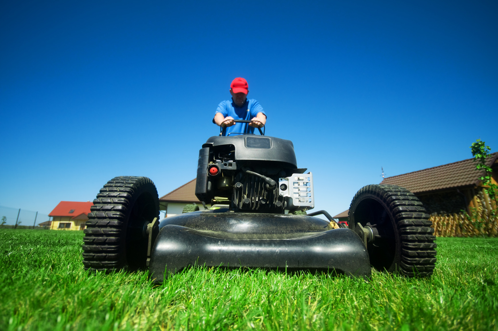 man mowing the lawn on a riding grass mower