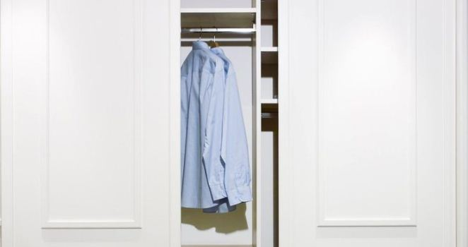 Blue Shirt Hanging In White Closet