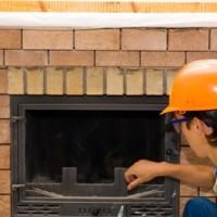 man near a brick fireplace
