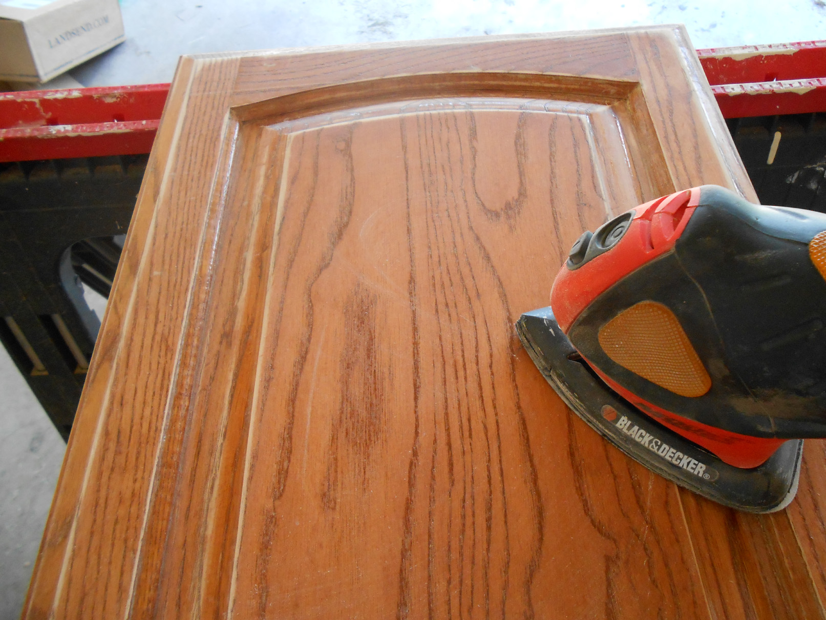 superb Sanding Kitchen Cabinet Doors #2: ... man sanding a door of a kitchen cabinet