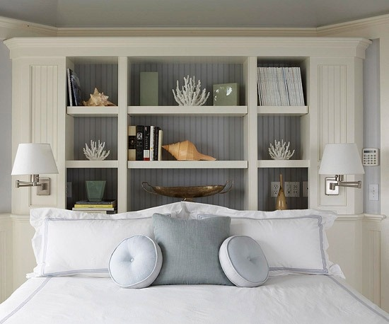 shelving behind the bed in smaller bedroom