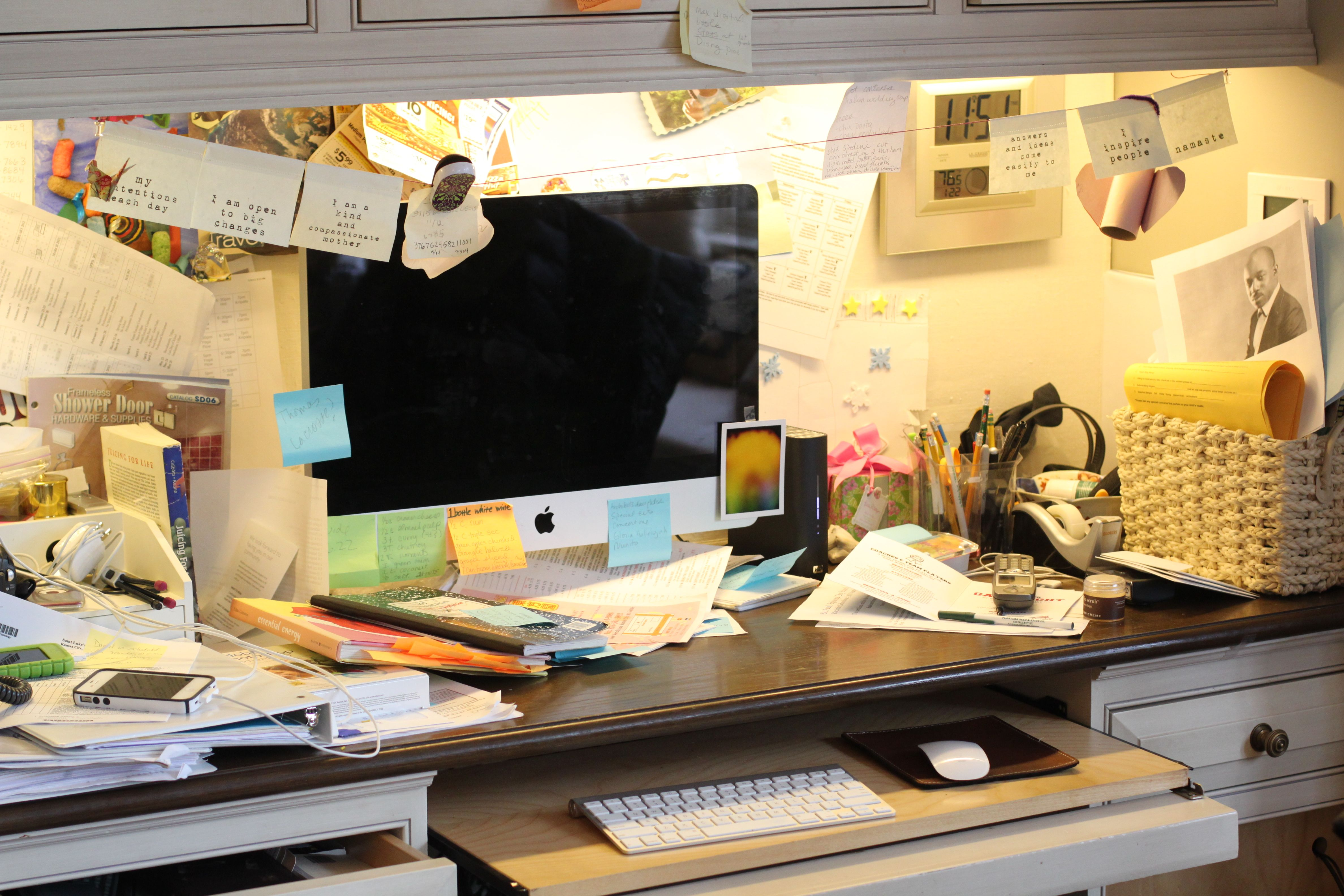 extremely cluttered office desk