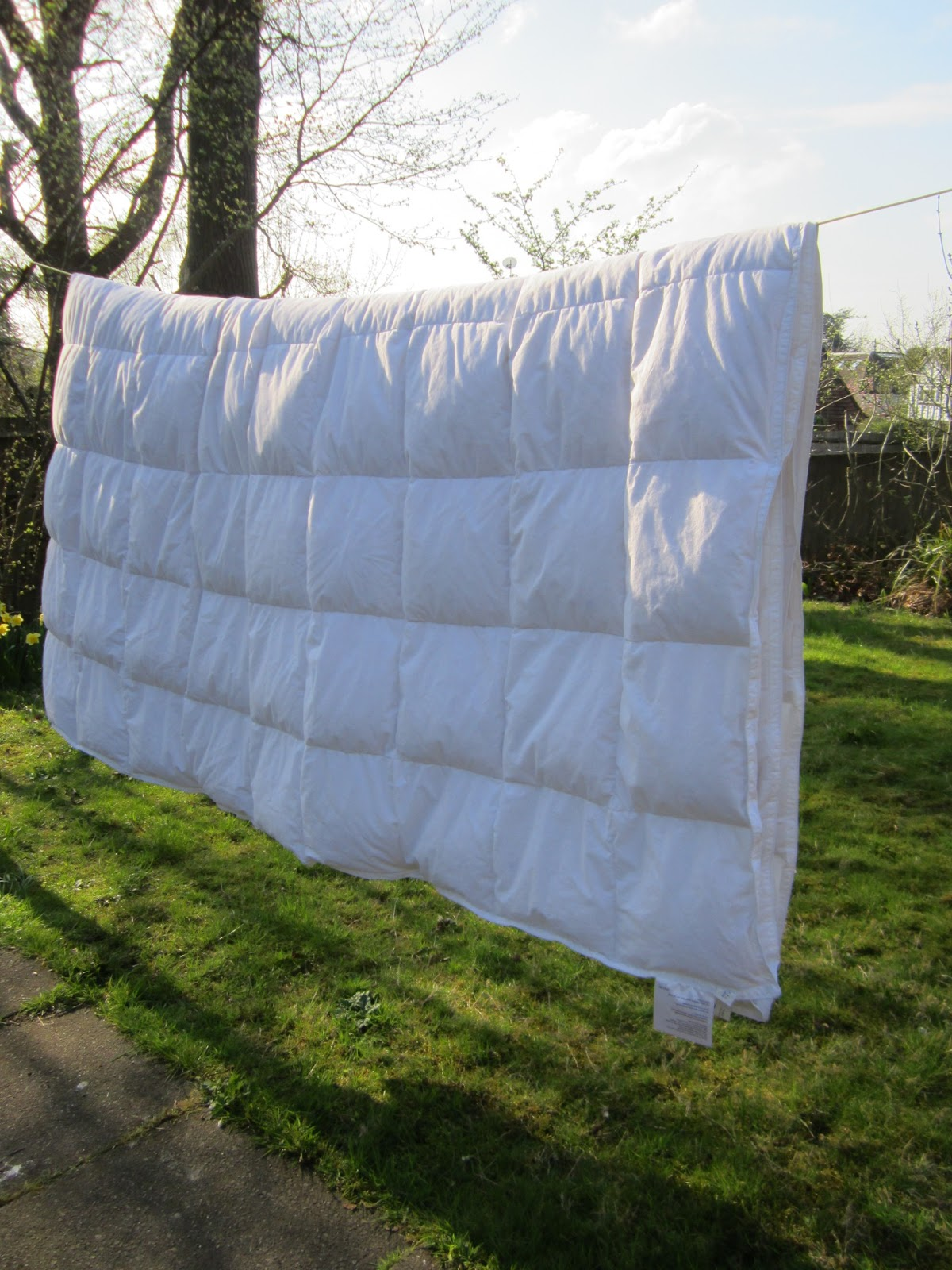 duvet being aired out outside