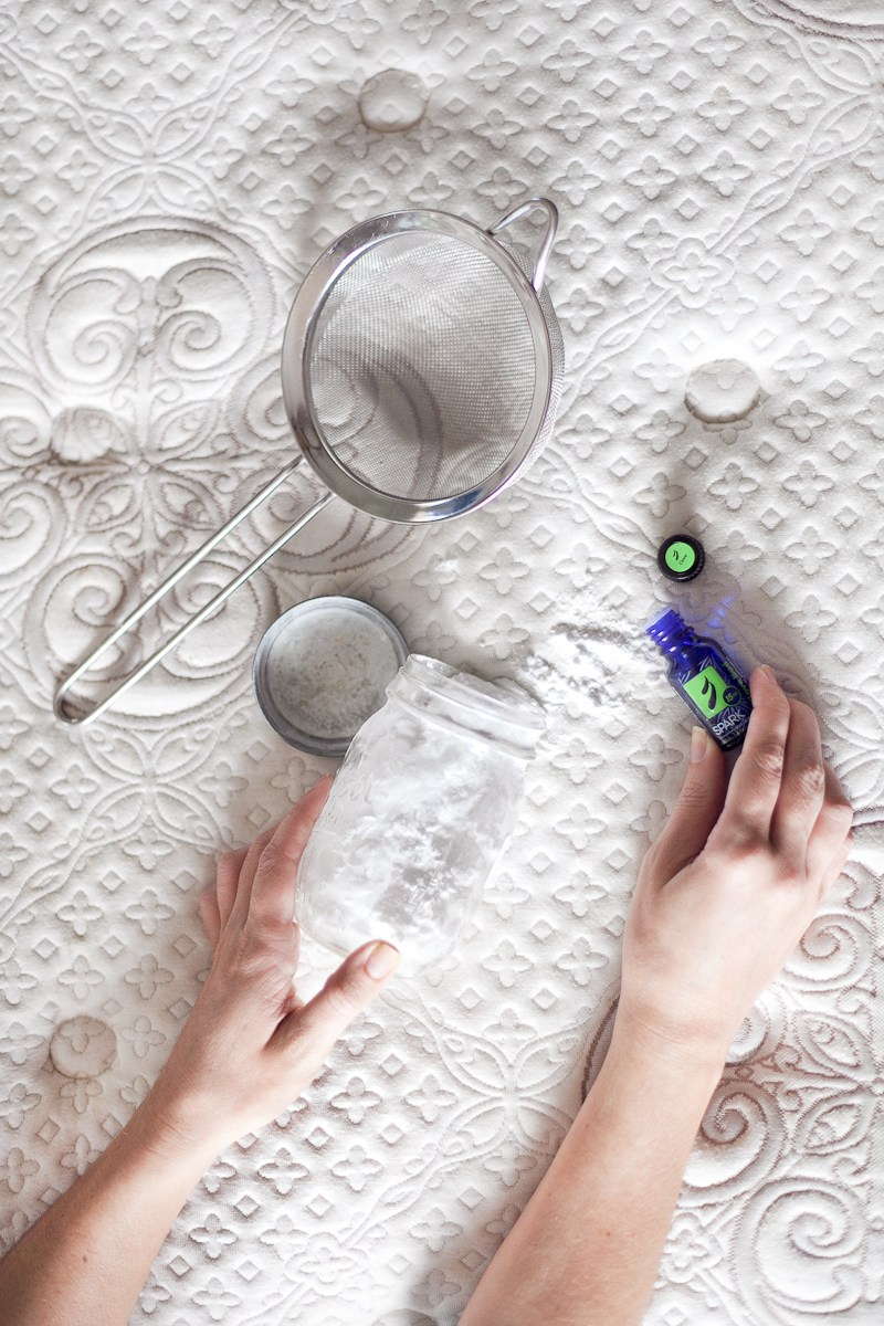 woman getting readty to clean the mattress with baking soda