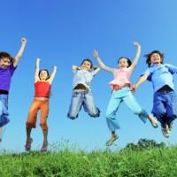 kids jumping in summertime