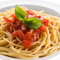 pasta with sauce on white plate