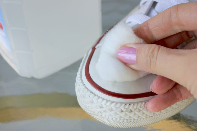 cleaning white shoe with cotton disc and makeup remover