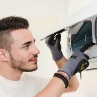 man replacing air conditioner