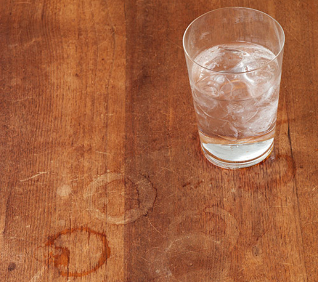 Cup Of Water And Stains On Wood