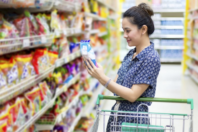 woman looking at the product in grocery store