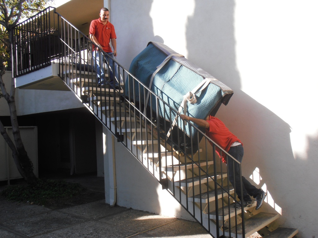 moving piano down the stairs