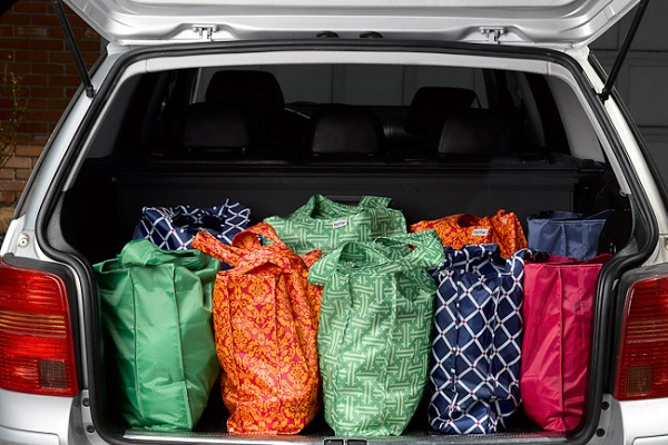 reusable bags with groceries in car trunk
