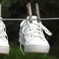 white shoes drying outside on a rope