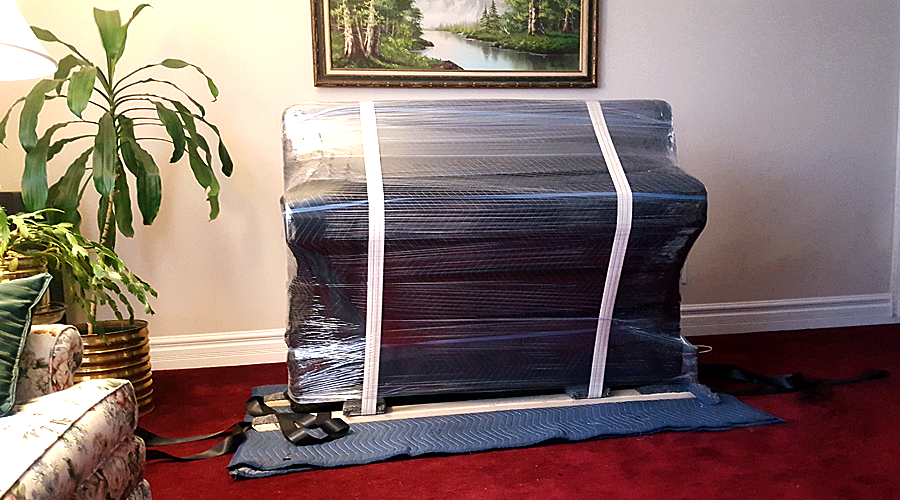 wrapped piano ready for move