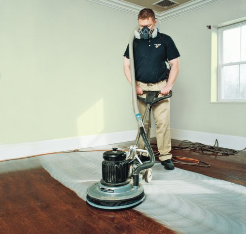 ... man sanding hardwood floors - Hardwood Floors Refinishing Guide HireRush Blog