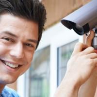 man near a security camera
