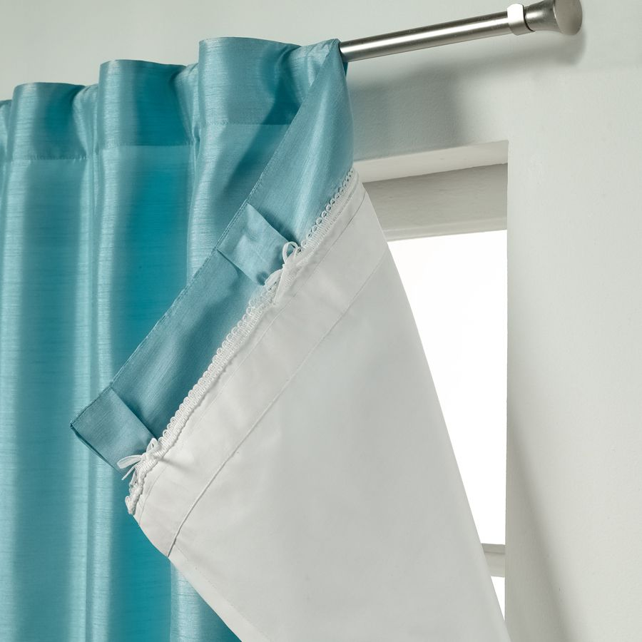 blue layered curtains on window