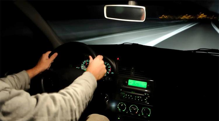 man driving at night