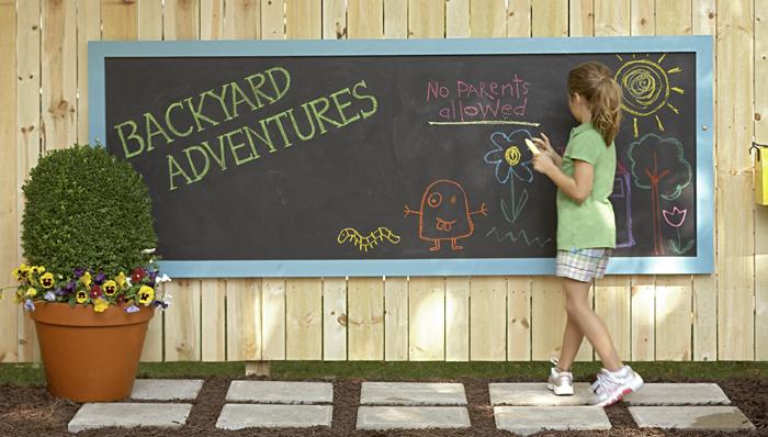 chalkboard on backyard fence