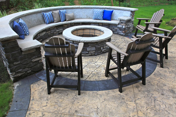stone firepit and benches in backyard