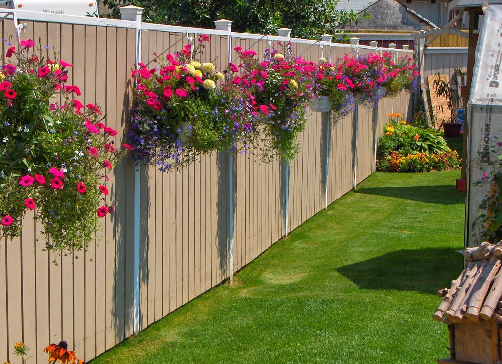 privacy fence with flower boxes