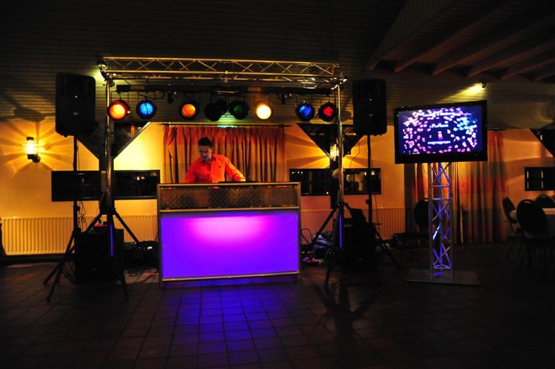 7 tips to hire wedding dj hirerush blog dj setting up equipment at reception venue junglespirit Image collections