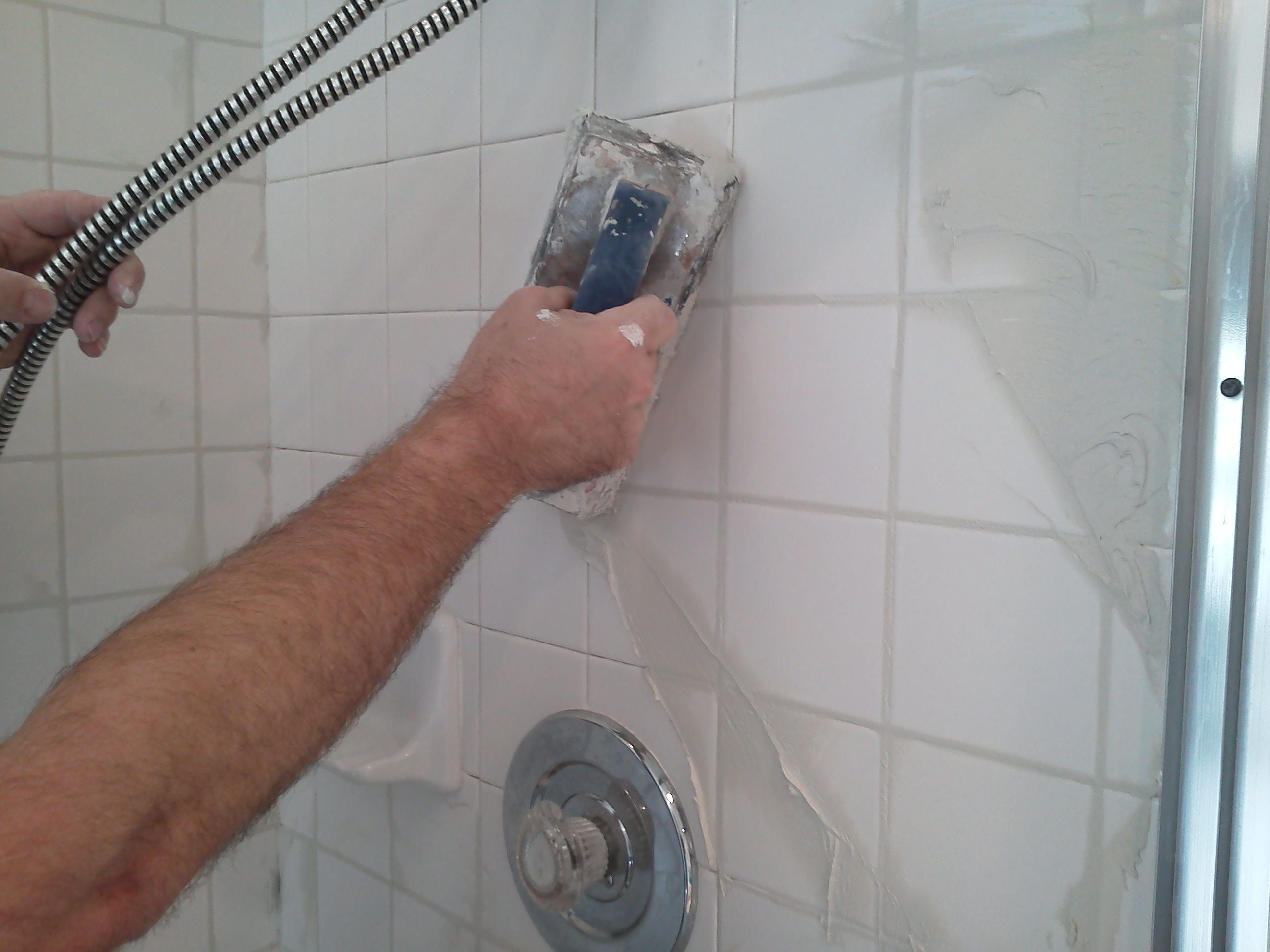 How to clean tile grout hirerush blog man regrouting tile dailygadgetfo Gallery