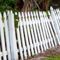 white wooden leaning fence