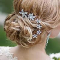 wedding hairstyles for long hair romantic low bun